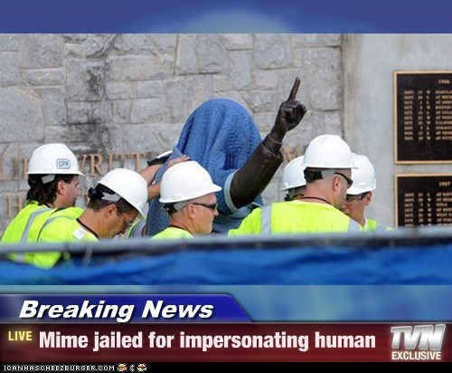 Joe Paterno mimes political pictures statue