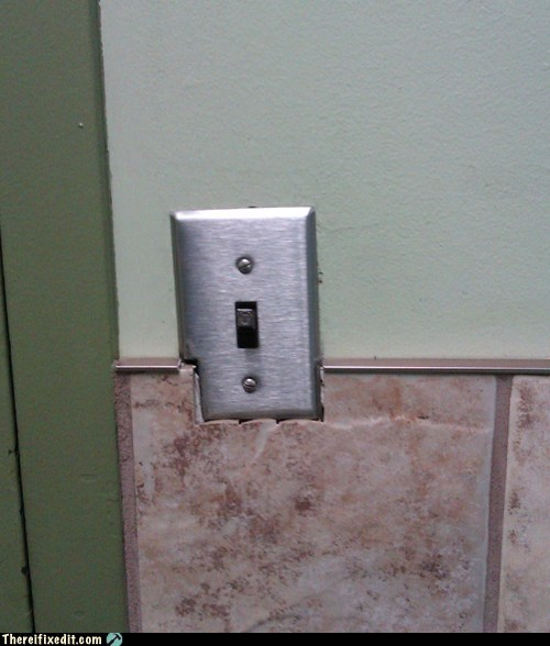 light switch,switch,tiles,wall tiles
