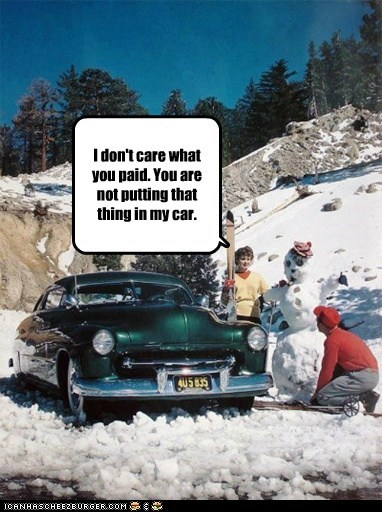 car,mountain,skiing,snowman,winter