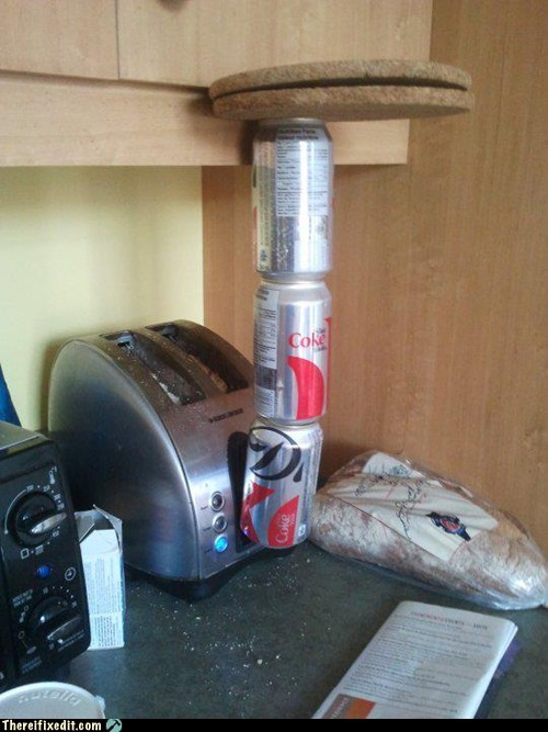 awry,bread,breakfast,diet coke,rye,toast,toaster