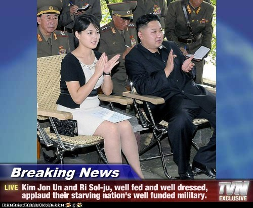 Breaking News - Kim Jon Un and Ri Sol-ju, well fed and well dressed, applaud their starving nation's well funded military.