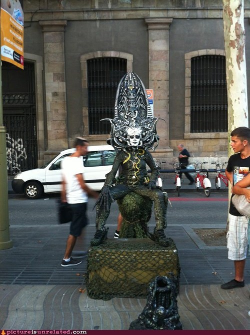 alien costume street performer