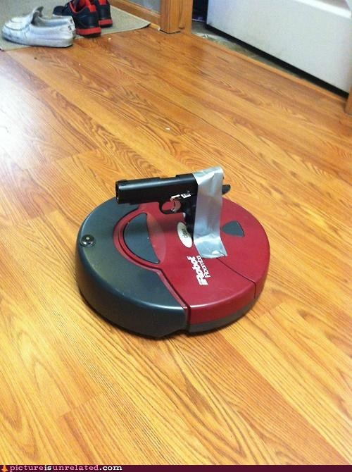 duct tape,guns,robot,roomba,vacuum,wtf
