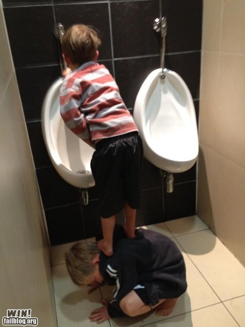 bathroom kids teamwork urinal