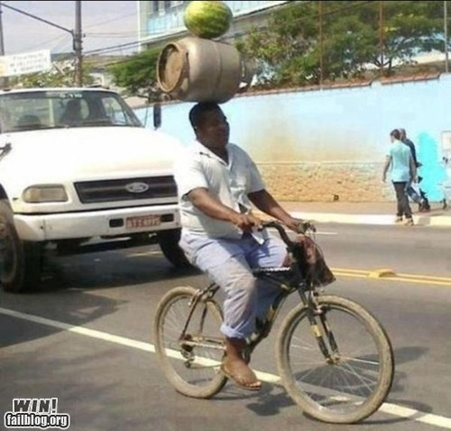 balance,barrel,bike,propane,watermelon