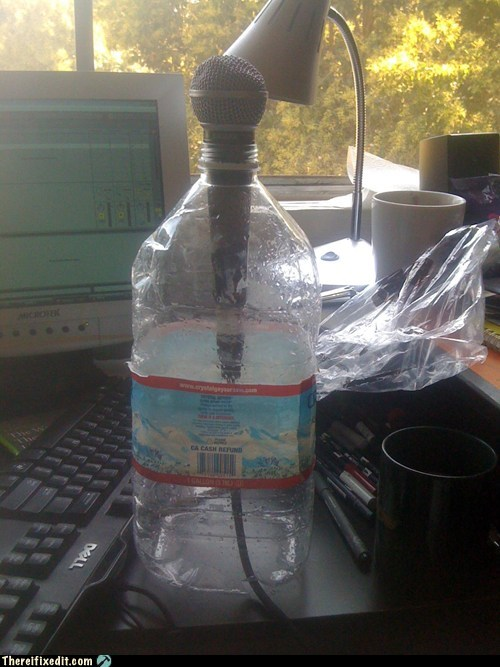 crystal geyser,microphone,microphone stand,water bottle,water jug
