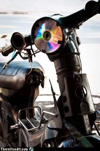 CD,disc,headlight,motorcycle,reflector