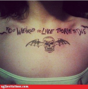 chest tattoos,skull,too rare to die,too weird to live