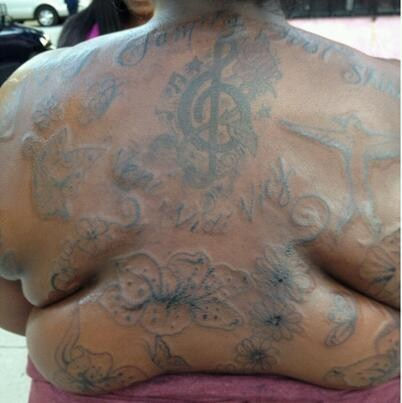 back tattoos,flowers,treble clef