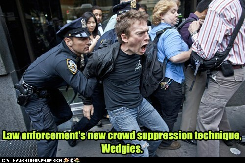 Law enforcement's new crowd suppression technique, Wedgies.