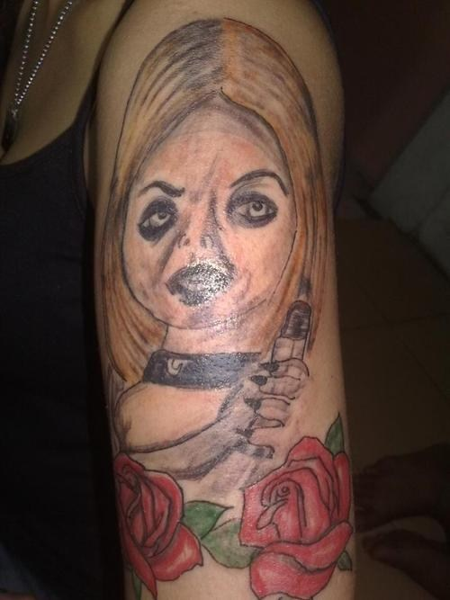 arm tattoos,Bride of Chucky,roses