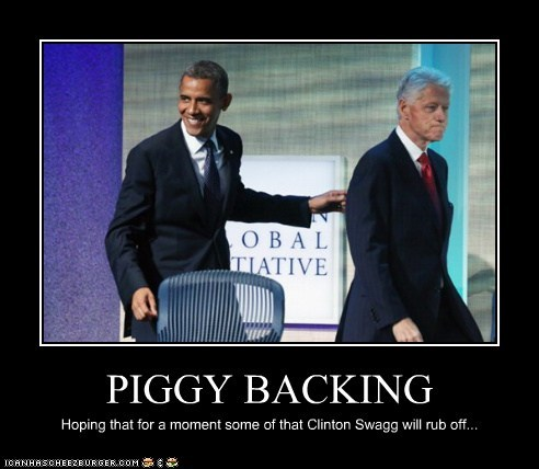 PIGGY BACKING Hoping that for a moment some of that Clinton Swagg will rub off...