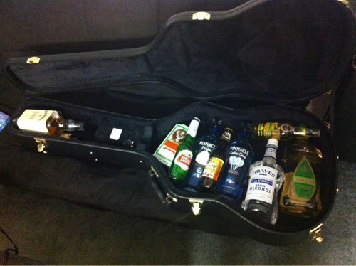 alcohol,guitar case,hard liquor,transporting