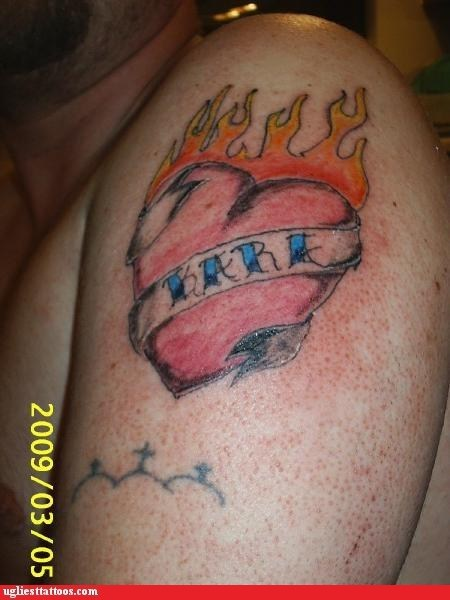 arm tattoos,heart,fire