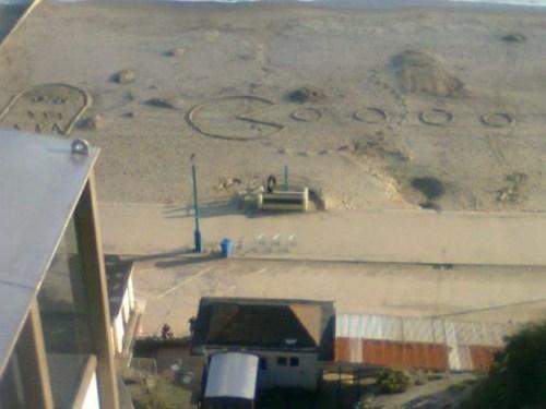 pac man nerdgasm sand drawing ghost beach - 6653899776