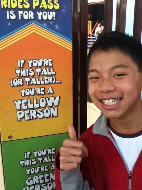 sign wording accidental racism amusement park