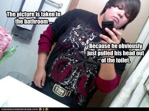 The picture is taken in the bathroom ... Because he obviously just pulled his head out of the toilet.