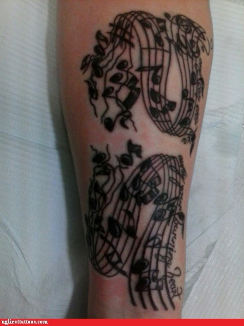 arm tattoos,music notation