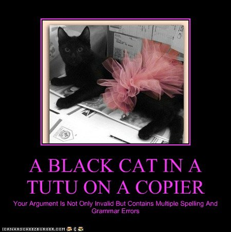 A BLACK CAT IN A TUTU ON A COPIER