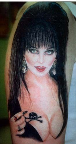 arm tattoo,elvira tattoo