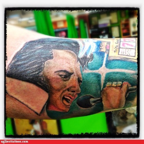 arm tattoos Elvis Presley