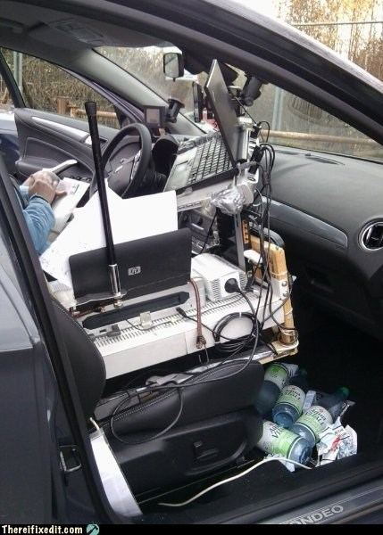 office car,mobile office,front seat,cluttered car,messy car