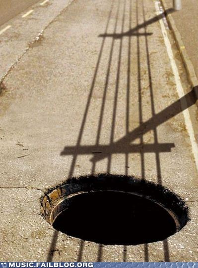 guitar,shadow,manhole