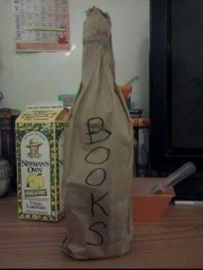 bottle,hidden,books,paper bag
