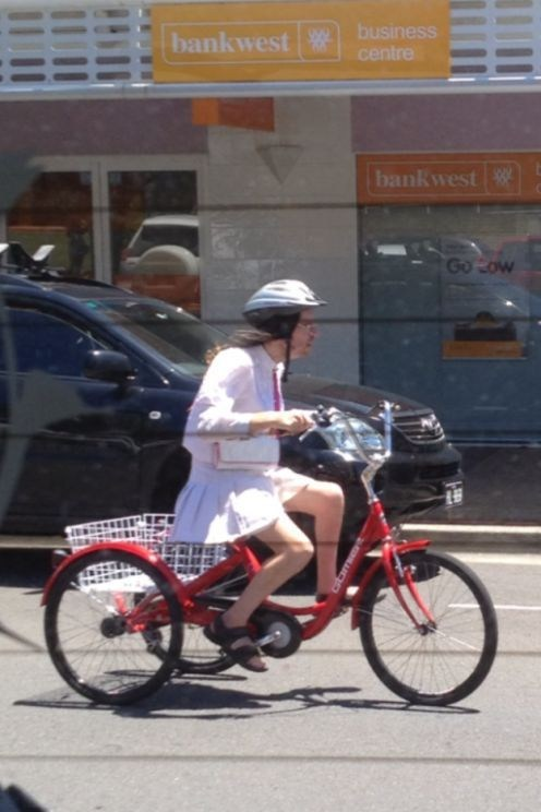 bicycle,cross dressing,man in skirt