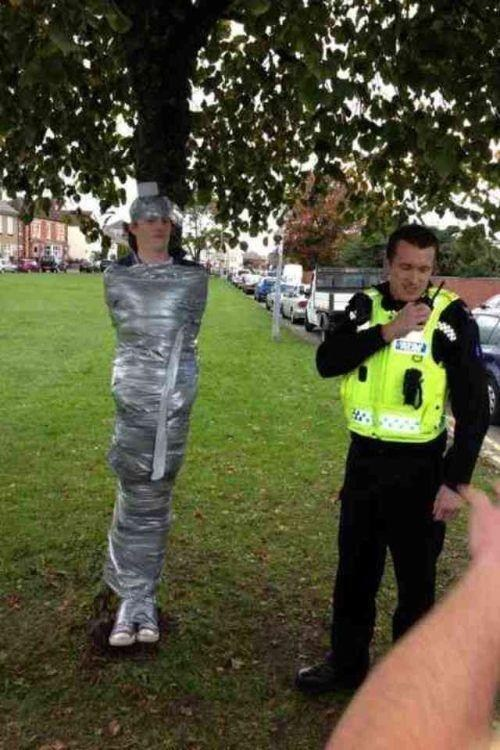 wtf,stuck,cop,prank,tree,duct tape,funny
