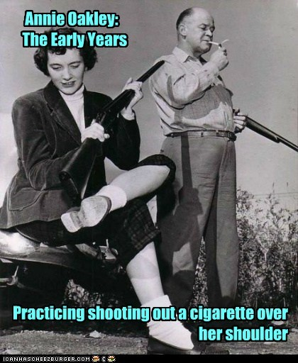 Annie Oakley: The Early Years Practicing shooting out a cigarette over her shoulder