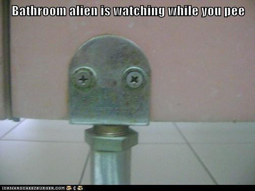 Bathroom alien is watching while you pee