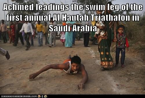 Achmed leadings the swim leg of the first annual Al Hautah Triathalon in Saudi Arabia