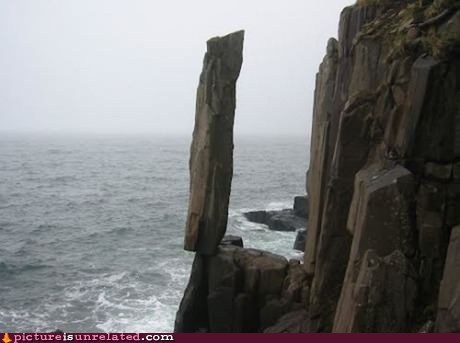 nature rock ocean cliff balancing act