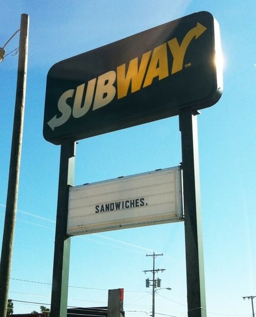 restaurant sign,billboard,sandwiches,Subway