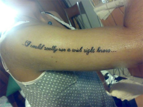 arm tattoos,misspelled tattoos