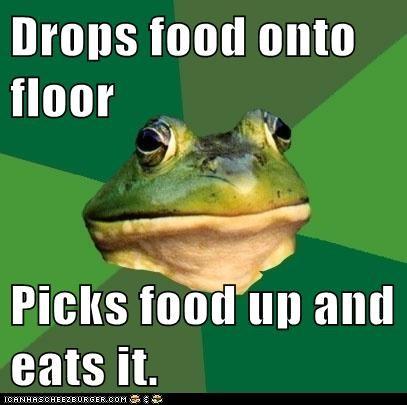 Drops food onto floor  Picks food up and eats it.