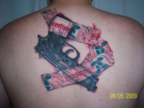 christmas,guns,back tattoos
