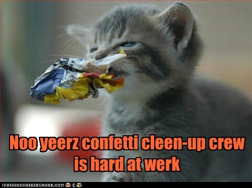 Noo yeerz confetti cleen-up crew is hard at werk