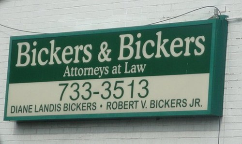 sign attorney lawyer fitting irony