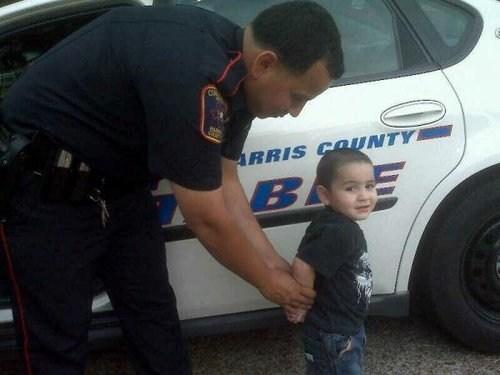 cops handcuffed police car - 6941087488