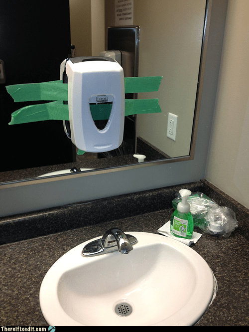 soap dispenser,soap,bathroom,duct tape