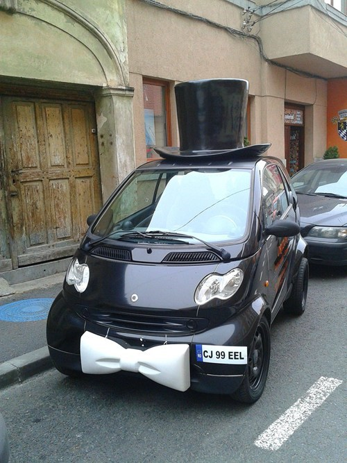 smart car,bow tie,top hat,sir