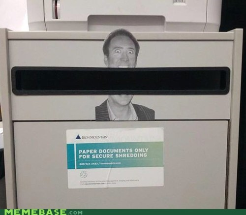 IRL creepy nick cage paper shredder