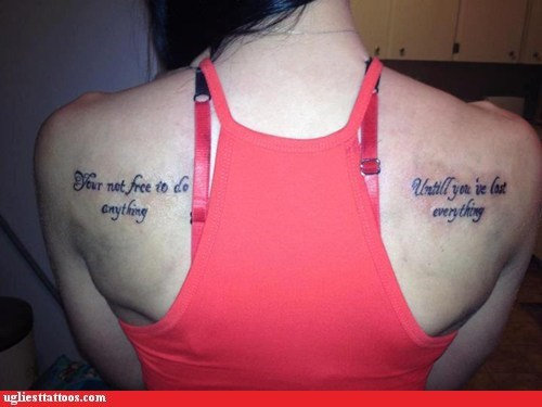 misspelled tattoos,back tattoos