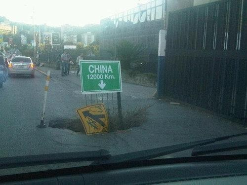 sign,watch your step,China,pit
