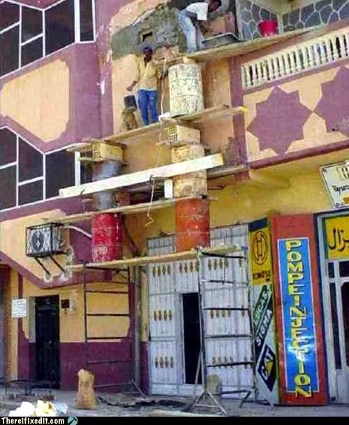 scaffolding construction balancing act - 7016372480