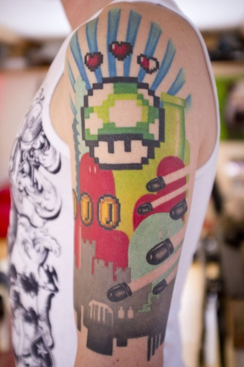 arm tattoos 1up Super Mario bros win g rated Ugliest Tattoos