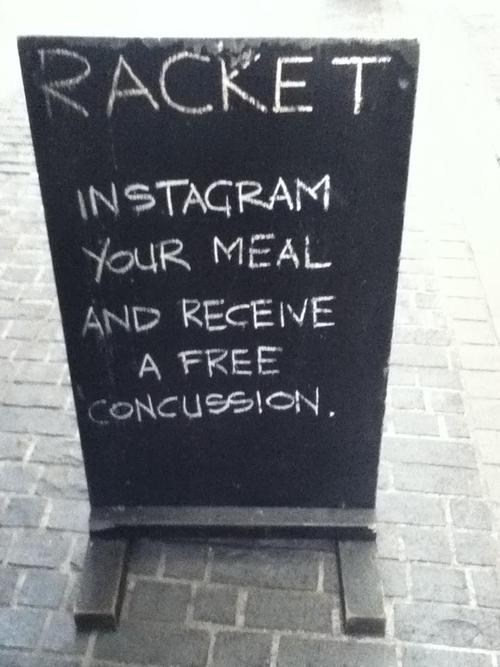 Funny picture of someone threatening to give a concussion to people who Instagram their meal.