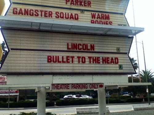 lincoln,sign,movie theater,juxtaposition